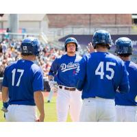 Alex Verdugo of the Tulsa Drillers Receives Congratulations following his Grand Slam