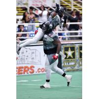 Wondell Rutledge of the Duke City Gladiators Lifts Dello Davis after a Davis Touchdown