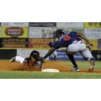 Deivi Grullon of the Greensboro Grasshoppers Tags out a Hickory Crawdads Baserunner