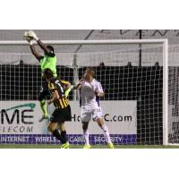 Charleston Battery Goalkeeper Odisnel Cooper catches a Louisville City FC Shot on September 12, 2015
