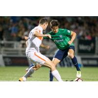 Orange County SC Midfielder Mats Bjurman Battles for the Ball
