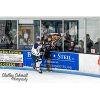 Janesville Jets Forward Brenden MacLaren against the Boards