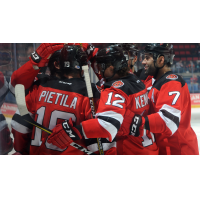 Binghamton Devils congratulate Nick Lappin on his goal