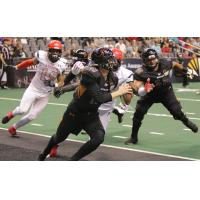 Arizona Rattlers Quarterback Jeff Ziemba avoids pressure from the Sioux Falls Storm