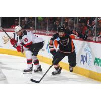 Lehigh Valley Phantoms Forward Phil Varone races to the puck against the Binghamton Devils