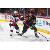 Lehigh Valley Phantoms Forward Mikhail Vorobyev controls the puck against the Binghamton Devils