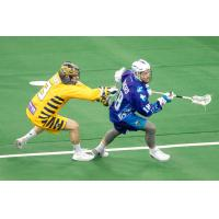 Jake Withers of the Rochester Knighthawks keeps possession against the Georgia Swarm