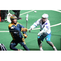 Lyle Thompson of the Georgia Swarm passes against the Rochester Knighthawks