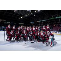 Kelowna Rockets pose in their Don Cherry uniforms