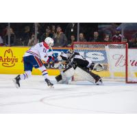 Vancouver Giants Goaltender Trent Miner makes a glove save against the Spokane Chiefs