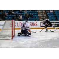 Ty Ronning of the Vancouver Giants Earn scores against Kamloops Blazers Goaltender Dylan Ferguson