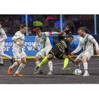 Milwaukee Wave Midfielder Ian Bennett battles for the ball