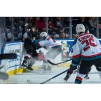 Kelowna Rockets Defenceman Gordie Ballhorn crushes and opponent while Liam Kindree looks on