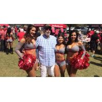 Carolina Cobras cheerleaders and fan