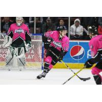 Idaho Steelheads Defenseman Shane Hanna and teammates in Pink in the Rink uniforms