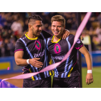 Las Vegas Lights FC Defender Marco Cesar Jaime Jr. (left) congratulates Midfielder Alex Mendoza