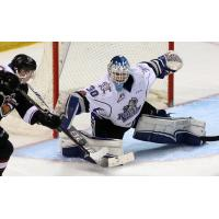 Victoria Royals Goaltender Griffen Outhouse stops a Vancouver Giants shot