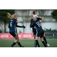 Seattle Reign FC teammates congratulate Megan Rapinoe on her goal
