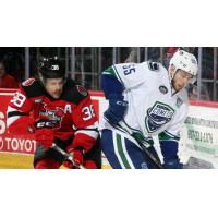Binghamton Devils Center Bracken Kearns vs. Utica Comets Defender Guillaume Brisebois