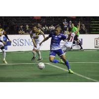 Miguel Angel Vaca tries to navigate past the Baltimore Blast defense
