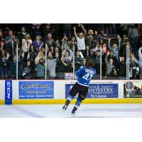Idaho Steelheads Forward Connor Chatham tosses T-shirts to the home crowd