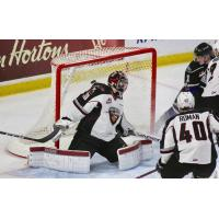 Vancouver Giants Goaltender David Tendeck holds off the Victoria Royals's charge