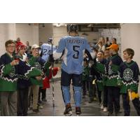Jack Dougherty of the Milwaukee Admirals greets kids during a game