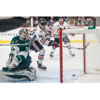 Joachim Blichfeld of the Portland Winterhawks scores against Everett Silvertips Goaltender Carter Hart