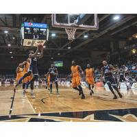 Halifax Hurricanes drive to the basket against the Island Storm