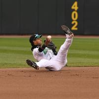 Dayton Dragons' Jose Garcia throws out a runner at second after a diving stop in the first inning