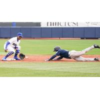 Errol Robinson of the Tulsa Drillers attempts to tag out a base runner in Sunday's game at ONEOK Field