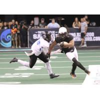 Anthony Amos of the Arizona Rattlers rounds the corner against the Cedar Rapids Titans