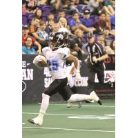 Raphael Lawson-Gayle of the Cedar Rapids Titans races for the endzone