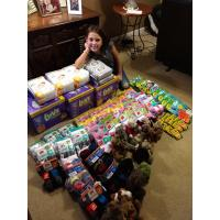 Olivia Velez with donated supplies