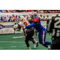 Florida Tarpons defensive lineman Dasmine Cathey makes a tackle against the Austin Wild