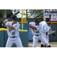 Josh Congdon and Josh McIntyre of the Medford Rogues practice on opening night