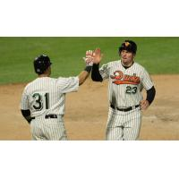 Ramon Cabrera and Travis Snider of the Long Island Ducks exchange high fives