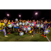 Las Vegas Lights FC players celebrate on the field