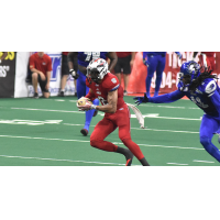 Jacksonville Sharks receiver Cody Saul makes a move against the Columbus Lions
