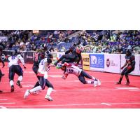 Frankie Solomon, Jr. of the Texas Revolution makes a tackle against the Amarillo Venom