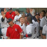Syracuse Chiefs exchange high fives in the dugout