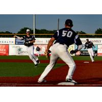 Dylan Bonhert of the Brazos Valley Bombers awaits a throw from the pitcher