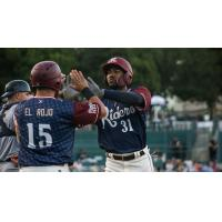 Destin Hood of the Frisco RoughRiders receives high fives
