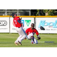 With outfielder AJ Lewis losing his cap, Victoria HarbourCats second baseman Rowdy Jordan makes a great catch