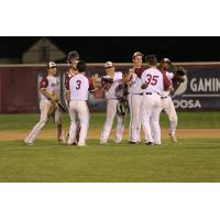 Wisconsin Rapids Rafters celebrate on the mound