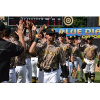 Sussex County Miners congratulate each other on a win
