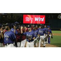 Frisco RoughRiders exchange congratulations after a win