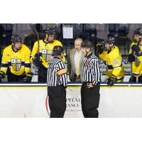 Mark Dennehy consults with the officials while with Merrimack College