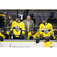Mark Dennehy shouts instructions while with Merrimack College
