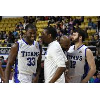 Flenard Whitfield and the KW Titans bench share a laugh